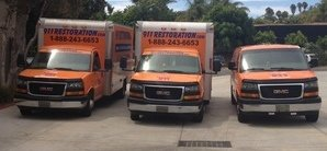 Water Damage Queen Creek Restoration Van And Trucks At Commerical Job Location