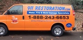 Mold and Water Damage Restoration Vehicle En Route To Job