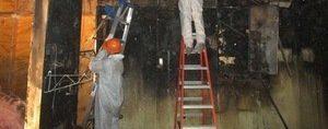 Water Damage Cowchilla Restoration Technicians Inspecting Water Leaks